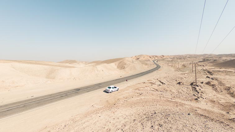 Renting a car in Iran. Car rental Iran. Traffic in Iran. our Peugeot 206 in the desert