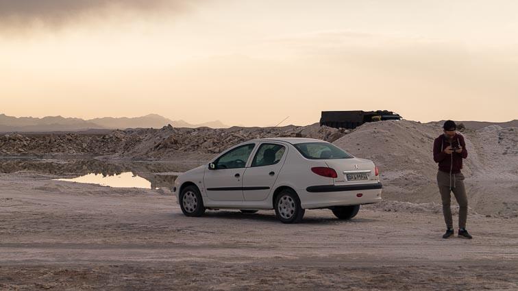 Renting a car in Iran. Car rental Iran. Traffic in Iran. our Peugeot 206 near a salt lake near Varzaneh