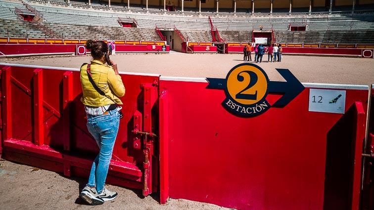 Kirsten standing alongside the bullring in Pamplona