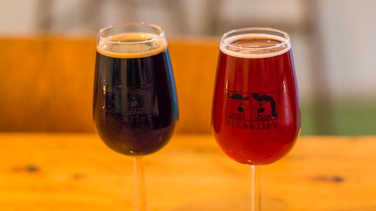 Two glasses of beer at the Mikkeller cafe (one stout and one fruity beer for Kir)