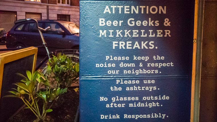 """Text on the wall outside Mikkeller & Friends bar. """"Attention Beer Geeks & Mikkeller Freaks. Please keep the noise down and respect our neighbors. Please use the ashtrays. No glasses outside after midnight. Drink responsibly"""""""