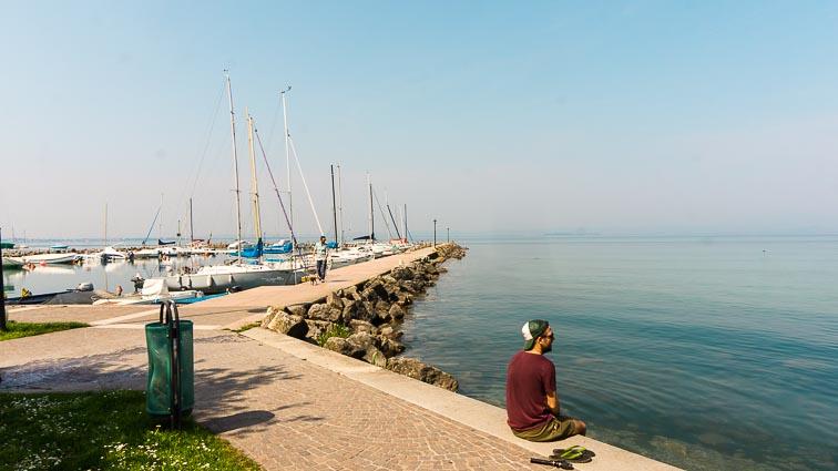Erick sitting on the docks near Pacengo