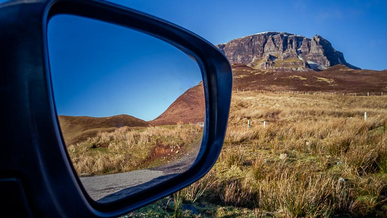 Mirror of our rental car on our Scotland Road Trip